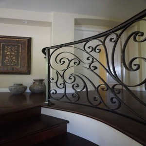Wrought iron rail with wood floor by general contractor