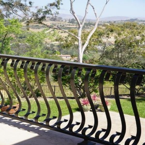 Wrought iron baluster railing design two story home remodel