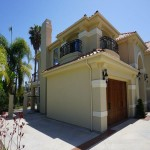Exterior of remdoeled Carlsbad home balcony design by DM Build