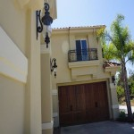 Exterior of Carlsbad Home Remodel. Mediterraininan style with wrought iron balcony rail
