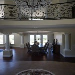 Wrought iron rail balcony overlooking interior living room remodel and addition Carlsbad CA