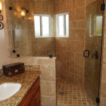 Custom bathrooms large walk in shower and vanity sink by DM Building INC.