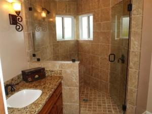 Custom bathrooms large walk in shower and vanity sink by DM Building INC.