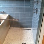 Custom bathroom remodel with pebble tile flooring Encinitas, CA