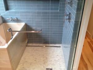 Custom bathroom remodel with pebble tile flooring Encinitas, CA