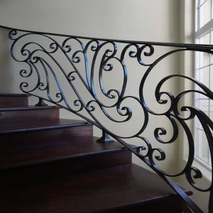 Wood staircase with wrought iron rail