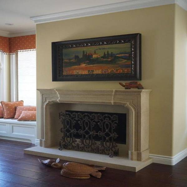 Living room Stone fireplace design by home builder DM Build