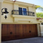 Custom wood carriage garage door Carlsbad home remodel