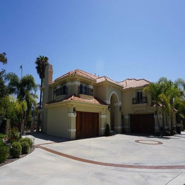 New Mediterranean Carlsbad home designed by Carlsbad custom home builder DM Build