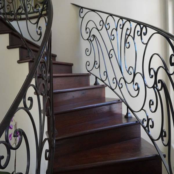 Mediterranean wrought iron baluster staircase design Carlsbad CA