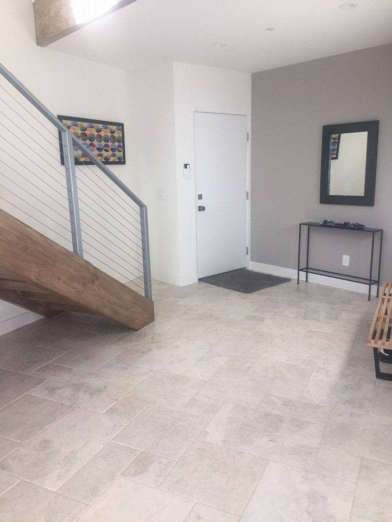 Modern tile entryway with staircase